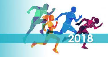 Silhouettes de coureurs en couleurs avec l'année 2018 du côté droit de l'image