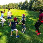 Programme DSPM Montréal-Athlétisme. Le groupe font l'exercice de courir sur place.
